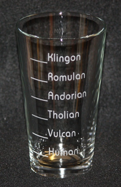 thedrunkenmoogle:  Star Trek Pint Glass Giveaway, Sponsored by FanBoyShirts With Star Trek: Into Darkness out in theaters, The Drunken Moogle and FanBoyShirts decided it would be an opportune time to give away a set of two Trek themed glasses. What goes in it and what level it gets filled to is entirely up to you! Romulan Ale is suggested. To Enter: Email thedrunkenmoogle@gmail.com with your favorite character from any Star Trek series. A random winner will be picked tomorrow (Saturday, May 18th 2013) and posted on the website. This contest is only eligible for the U.S.  The glass may be purchased on FanBoyShirts for $11.99.