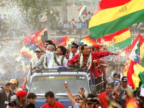Chávez rides through a crowd with Bolivian President Evo Morales in 2007. The two were announcing that money from Venezuelan oil would fund a huge power plant in Bolivia.