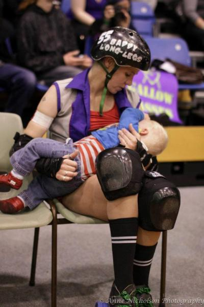 Feeding my 6 month old at half time.Baddy Long-Legs - Otautahi Roller Derby League, Christchurch, NEW ZEALAND