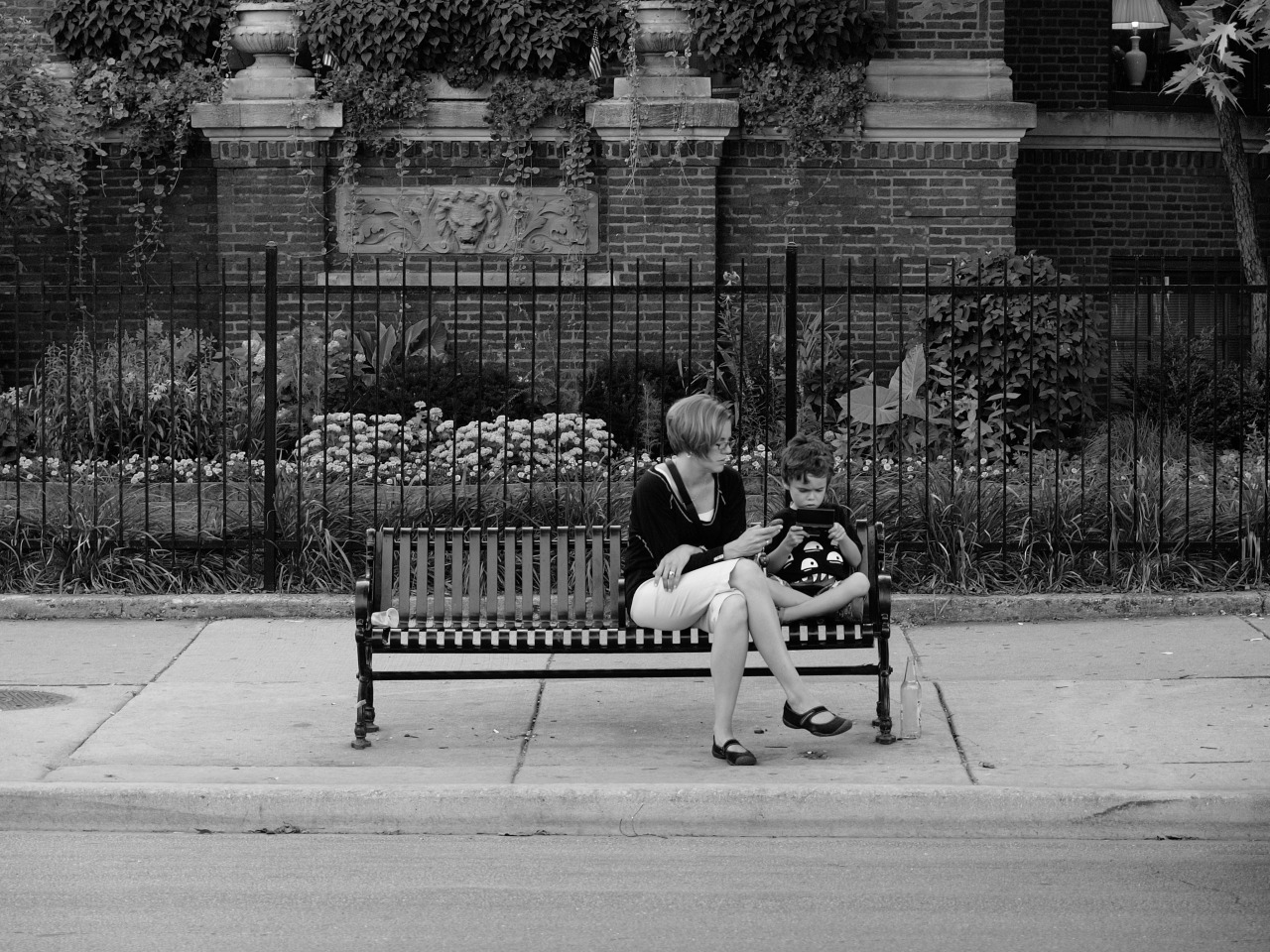 Mother and Son at Bus Stop - July 2010 - Uptown, Chicago, IL