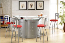 Retro home bar in silver metal & red accent barstool cushions.