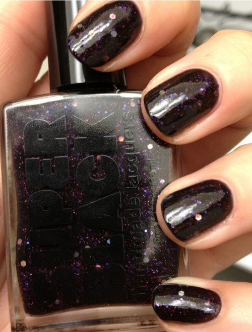 superblacklacquers:  becktasm:  Super Black Son of Space Ghost  Whoa!!!  I'm sporting this number right now.  It's awesome.  Only problem is it takes like 20 years to take off.  And that's not really a problem.  So yeah.  It's awesome and the best.