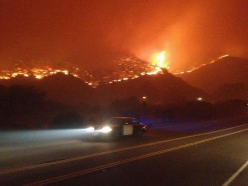 The Springs Fire has now hit PCH. Fuck.  Some numbers:  -Started around 6:30am on Thursday morning -8,000 acres, 10% contained -2,000 homes have been threatend, 15 sustained damage, none were destroyed. -925 personnel are now committed to the fire. -Road Closures, PCH between Las Posas and Yerba Buena, Yerba Buena Rd., Deer Creek Rd.  Updates and a map here: http://fire.countyofventura.org