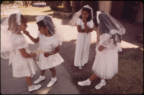 thesocialistkitty:  First Communion at St. Joan of Arc church, May 1972. Photo by Charles O'Rear