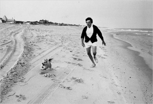 Kurt Vonnegut frolicking with his dog, Pumpkin.