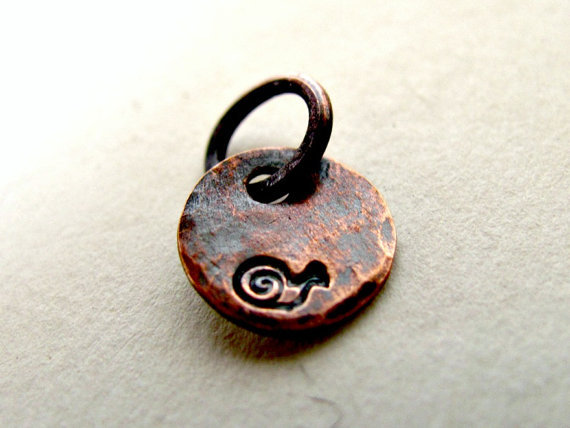 (via Tiny Snail Copper Charm Oxidized by stephaniedistler on Etsy)