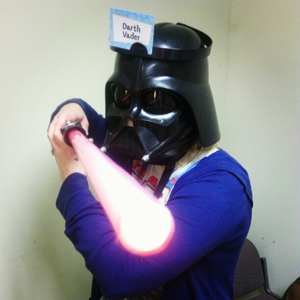 She just had to do it. #starwars #darth #vader #helmet #lightsaber #hedbanz
