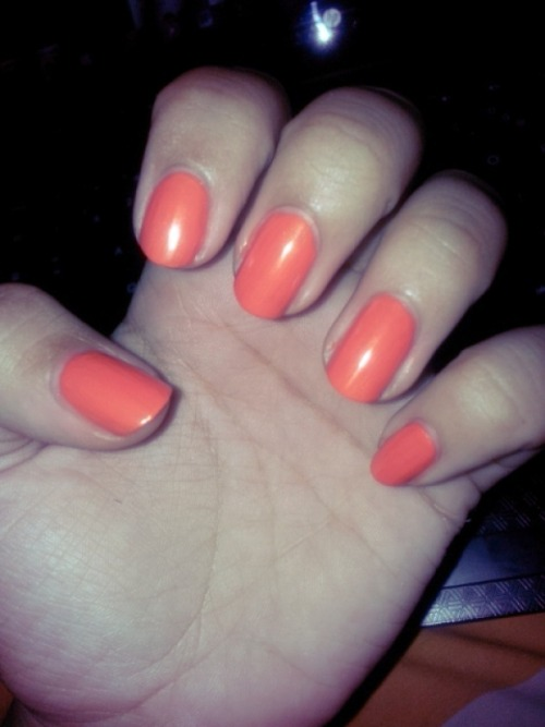 heavyheartthinking:  In another news, I just painted my nails orange.
