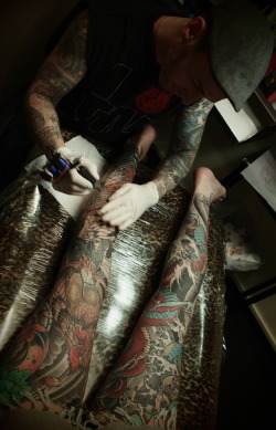 guyletatooer:  Geordie at work on an amazing body suit . At Tattoo Magic . Intense ….