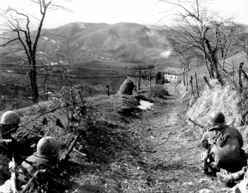 GIs of the 10th Mountain Division watching for enemy movement outside the Italian town of Sassomolare, 1945