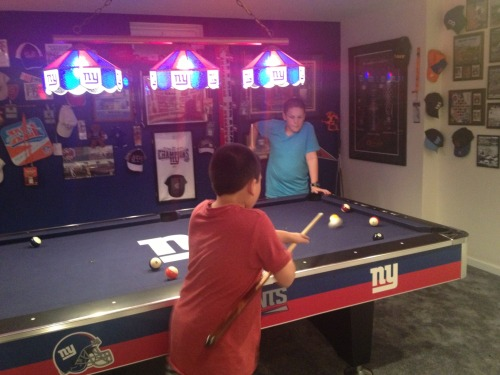 Ethan and Zach shooting pool…