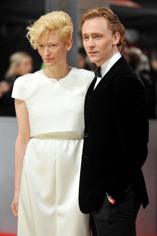 Tom Hiddleston and Tilda Swinton attend the Orange British Academy Film Awards 2012 at the Royal Opera House on February 12, 2012 in London, England [HQ]