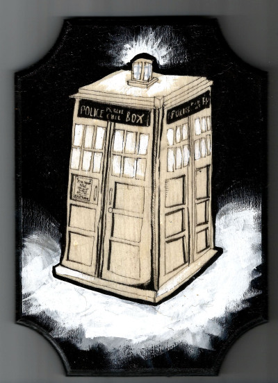 TARDIS illustration on a wooden plaque.