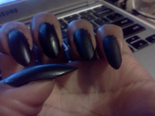 better shot of my nails. i reshaped em to claws. they'll get pointier as they get longer.