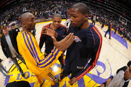 nba:  Kobe Bryant of the Los Angeles Lakers greets Kevin Durant of the Oklahoma City Thunder before their game at Staples Center on January 11, 2013 in Los Angeles, California. (Photo by Andrew D. Bernstein/NBAE via Getty Images)