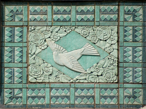 Chicago, Illinoisby Terence Faircloth Bird flying on the side of a building. From Flickr:  Art deco ornamentation on a building on West Elm Street at State Street in Chicago, Illinois.