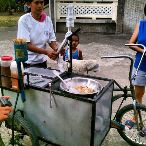 Forget food trucks. They got food bikes. Haha. The Fishball lady.  Pangasinan, philippines