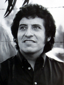 "Víctor Lidio Jara Martínez was a Chilean teacher, theatre director, poet, singer-songwriter, political activist and member of the Communist Party of Chile.  A distinguished theatre director, he devoted himself to the development of Chilean theatre, directing a broad array of works from locally produced Chilean plays, to the classics of the world stage, to the experimental work of Ann Jellicoe.  Simultaneously he developed in the field of music and played a pivotal role among neo-folkloric artists who established the Nueva Canción Chilena (New Chilean Song) movement which led to a revolution in the popular music of his country under the Salvador Allende government.  Shortly after the Chilean coup of September 11, 1973, he was arrested. In the hours and days that followed, Jara was repeatedly beaten and tortured; the bones in his hands were broken, as were his ribs. Fellow political prisoners have testified that his captors mockingly suggested that he play guitar for them as he lay on the ground with broken hands. Defiantly, he sang part of ""Venceremos"" (We Will Win), a song supporting the Popular Unity coalition.[6] After further beatings, he was machine-gunned on September 16, his body dumped on a road on the outskirts of Santiago and then taken to a city morgue where 44 bullets were found in his body. The contrast between the themes of his songs, on love, peace and social justice and the brutal way in which he was murdered transformed Jara into a symbol of struggle for human rights and justice worldwide. On December 3, 2009, a massive funeral took place in the ""Galpón Víctor Jara"" across from ""Plaza Brazil"". Jara's remains were honoured by thousands. His remains were re-buried in the same place he was buried in 1973. On December 28, 2012 a judge in Chile ordered the arrest of eight former army officers for alleged involvement in the murder of Victor Jara. (Source: Wikipedia)"