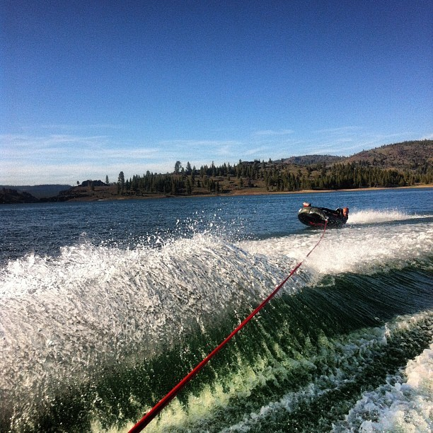 Ryan stokes tearin it up on the tube! @paintingitgray #tube #tubing #boat #water #lake #eatshit