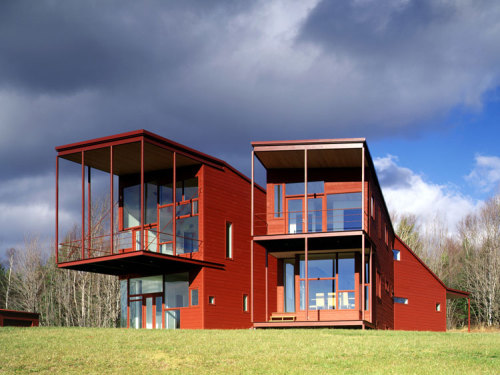 "yes please.Y House in Catskills, New York - Steven Holl Architectsvia:plusarchitekt On a hilltop site in a remote section of the Catskill Mountains, the ""Y"" House ascends the hill, splitting to form two arms, ending in balconies. The ""Y"" cuts a slice of sky and draws the sun into the heart of the house. Like a found forked stick, the Y makes a primitive mark on a vast site. The geometry contains a sectional flip of public/private and day/night with bedrooms below and living above. Maximum wall hanging space to accommodate a contemporary art collection is balanced with windows framing unique views. Deep balconies facing nearly due south act as passive solar devices allowing the winter sun to penetrate the interiors while excluding the hot summer sun. Steel framing and roof are iron-oxide red, siding is stained cedar while interiors are white with ash floors."