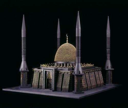 "Al Farrow's Reliquaries series depicts the holy buildings of various religions using bullets, missiles, shells, and other weapons.   Shown here: Mosque III (after National Mosque of Nigeria)Tank killer missiles, Bullets,Shell casings, Steel, Trigger.25""H x 31""W x 29""D2011"