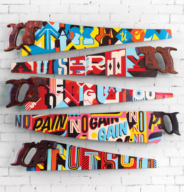 Hand-painted typographic saws by Vault49