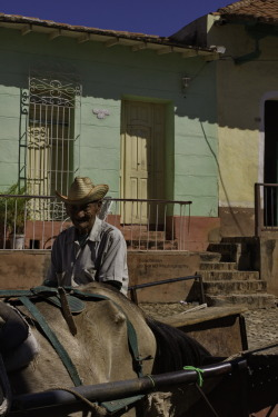Coachman Old Coachman in the Streets of Trinidad, Cuba. Canon EOS 40D 1/640s ISO 400 f/16 Trinidad, Cuba Flickr - Twitter - Facebook - Google+ - Posterous - 500px Copyright © BorisJ Photography - Boris Jusseit - all rights reserved - please do not use this image on any media without my permission.