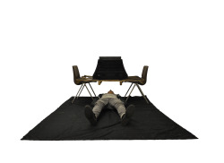 Milk installation - television, two chairs, black cloth, video (18.15)  'Milk' is expanded cinema, dislocating the first scene of Tarantino's 'Inglourious Basterds' to create an unnerving physical experience.  With similar intent to Pierre Bismuth's rework of 'The Jungle Book', something that was intended to be understood by all has been made relatively incomprehensible. The installation and video manipulate the viewer's focus to heighten their sensitivity to and change their perspective to replicate that of the Jewish families under the floorboards in the scene. To emphasise the labour and enduring tension of the character's context, the bottom of the crate has been painstakingly coloured in black using pens and pencils.    The 18-minute scene's dialogue has been replaced by a mix of the film's French, German and Spanish language trailers. The installation subverts the importance of language and communication in the creation of immersive cinema and transcends the impact of atmosphere and tension. The only sounds kept from the scene aside from background noise are the family's names when they are read.   The new dialogue mix is extremely loud whilst the original background noise is almost inaudible. This frustrates and forces the viewer to physically navigate the small space as they attempt to negotiate and settle in their new environment.