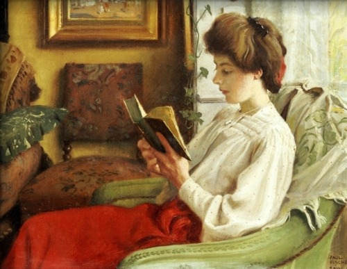 books0977:  A Good Book (1905), Paul Gustave Fischer (Danish, 1860-1934). Warm and inviting, has multi-colored furniture all jumbled close together, a trickle of ivy, and the rumpled throw on the chair. The reading woman herself appears comfortable and peaceful. Red flows through her cranberry colored skirt, her soft blouse with the faintest of red polka dots, and the red ribbon in her hair. Her cheeks have the faintest of blushes and her mouth opens slightly, as if she might be reading something romantic or even a tiny bit risque.