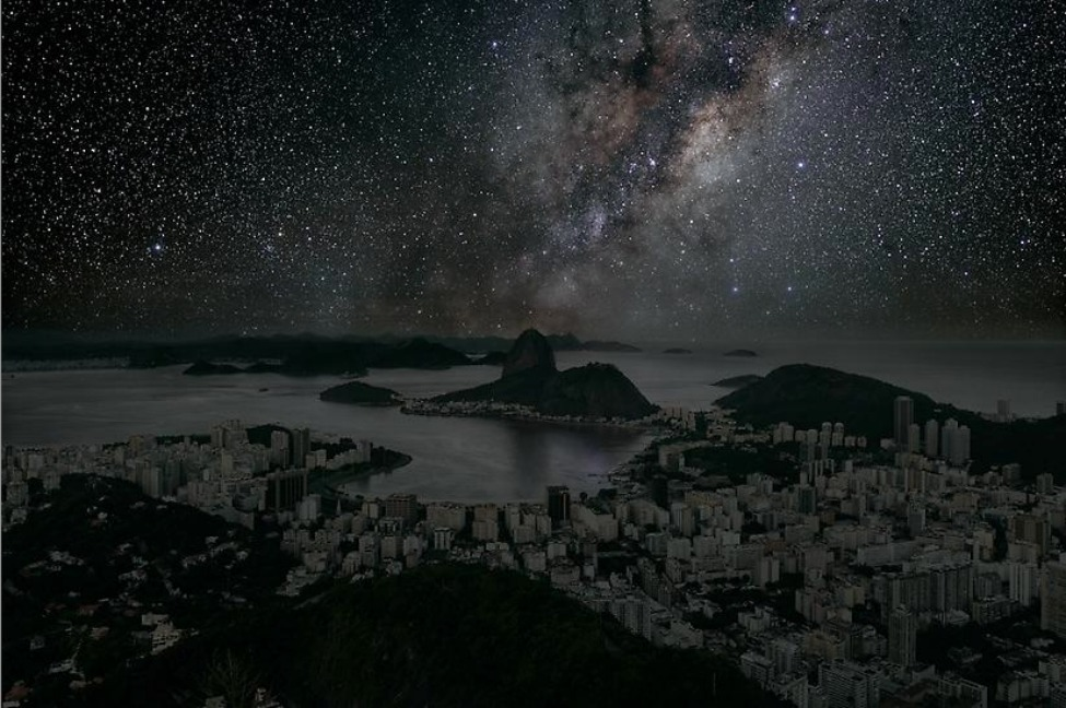 "What Major World Cities Look Like at Night, Minus the Light Pollution  French photographer Thierry Cohen worries about city dwellers not being able to see the starry sky. With light and air pollution plaguing urban areas, it is not as if residents can look up from their streets and roof decks to spot constellations and shooting stars. So, what effect does this have? Cohen fears, as he recently told the New York Times, that the hazy view has spawned a breed of urbanite, sheltered by his and her manmade environs, that ""forgets and no longer understands nature."" The photographer crisscrossed the globe photographing cityscapes by day—when cars' head and taillights and lights shining from the windows of buildings were not a distraction. At each location, Cohen diligently recorded the time, angle, latitude and longitude of the shot. Then, he journeyed to remote deserts and plains at corresponding latitudes, where he pointed his lens to the night sky. Through his own digital photography wizardry, Cohen created seamless composites of his city and skyscapes. Continue reading and see photos of darkened New York, Paris, Tokyo and more at Smithsonian.com. Photo: Rio de Janeiro 22° 56′ 42″ S 2011-06-04 Lst 12:34. © Thierry Cohen"
