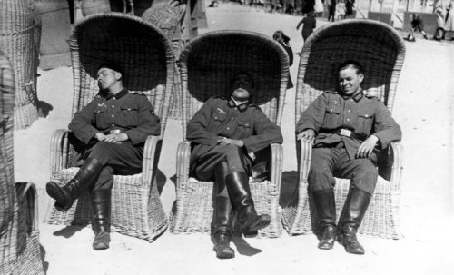 Week after the invasion of the Netherlands. German soldiers sits in beach chairs, enjoying the spring sunshine in Scheveningen. Netherlands, 19 May 1940.