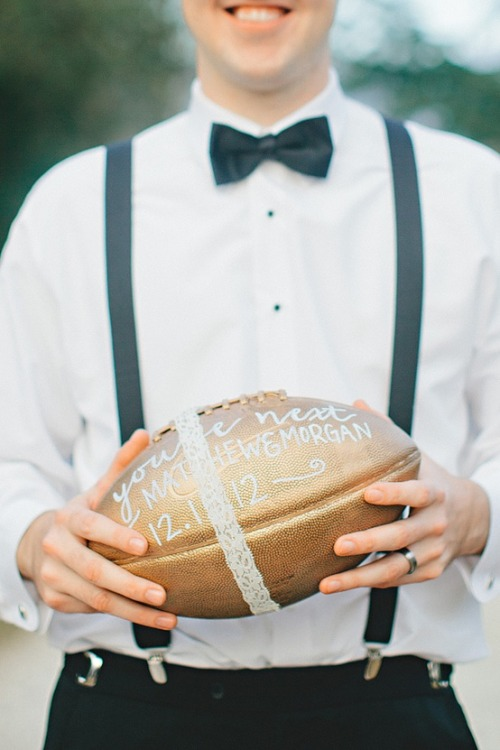 bride2be:  a football for the garter toss!  YOU GUISE, Have any of you seen The Room? A TUXEDO WEARING FOOTBALL PLAYER. Oh god.