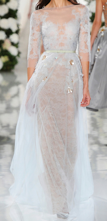 transparent-flowers:  stopdropandvogue:  Valentin Yudashkin sent down an absolutely gorgeous and delicately feminine collection for his Spring/Summer 2015 collection. Flower appliqué and immaculately precise stitching accompanied ethereal silhouettes. There were billowing skirts, elegant daywear and pink floral pieces that personified Hans Christian Andersen's Thumbelina. Hand-painted watercolors and pastels juxtaposed the metallic filigree in a strikingly luxurious way. When you lacquer something in gold, it becomes that much more precious. The models looked like walking vases - an open canvas for blooming life and rejuvenation. The dresses could be mistaken for floral couture, as if a garden was blooming directly on them. A palette that consisted of the colors of clouds could only be fit for a modern Disney princess and her woodland nymph counterpart. Photographed by Vogue Italia  aesthetic goals