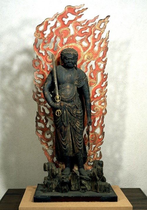 Standing Fudo Myō-ō (11th century) - King of Mystical Knowledge and One Really Mean god… The Myō-ō are warlike and wrathful deities that appear with furious faces and fire to frighten non-believers into accepting the teachings of Esoteric Buddhism. Introduced to Japan in the 9th century by Japan's Shingon and Tendai sects, the Myō-ō were originally Hindu deities. Elaborate and secret ritual practices are used to help partitioners develop and realize the eternal wisdom of the Buddha.This form of Buddhism is not taught to the general public, but is confined mostly to Buddhist believers, priests and those far along the path toward enlightenment.