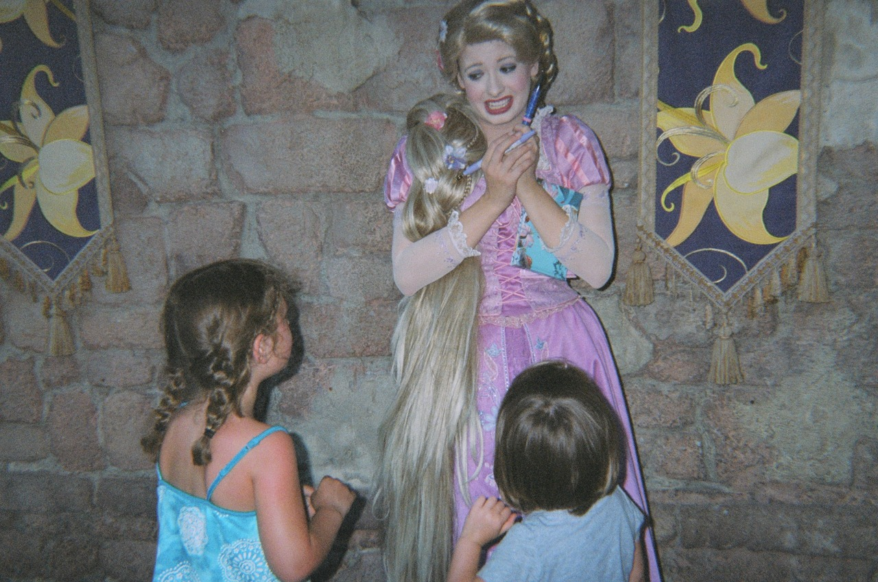 history1970s:  boyinflowers:  i found a CD of a families trip to disney land or whatever…  that's the best rapunzel i've ever seen