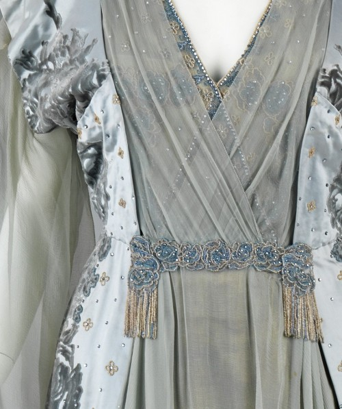 Tea Gown (Detail) by House of Worth, 1910. This was worn by the wife of one of the great American bankers of the 19th century, J.P. Morgan, Jr. (1867-1943). It exemplifies the grandeur of Worth clothing among wealthy Americans, who aspired to be associated with European royalty.
