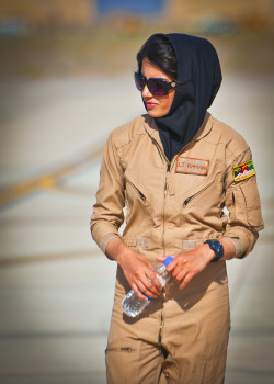 jedsundwall:  First female Afghan pilot graduates.  Afghan Air Force 2nd Lt. Niloofar Rhmani walks the flightline at Shindand Air Base, Afghanistan prior to her graduation from undergraduate pilot training May 13, 2013. Rhmani made history May 14, 2013 when she became the first female to successfully complete undergraduate pilot training and earn the status of pilot in more than 30 years. She will continue her service as she joins the Kabul Air Wing as a Cessna 208 pilot.
