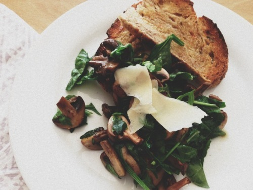 Sautéed mushrooms with spinach and Parmesan on toast.