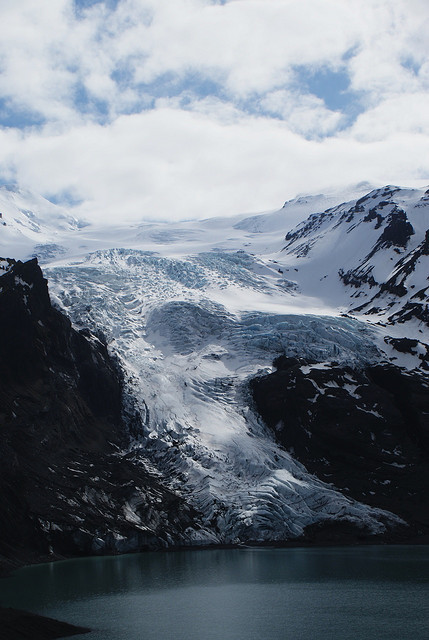 Nice shot of Gigjokull, a glacier in Iceland. Also, the word of the day is most definitely: Jökulhlaup! A Jökulhlaup is a type of glacial flood from volcanic or pressurized activity. Willum Griffith: Glacier  The glacier Gigjokull, an outlet of Eyjafjallajokull in Iceland. On March 20th 2010, just under a year after this was taken, a volcano in the area began to erupt, triggering fears of a jokulhlaup, or glacial outburst flood, from glaciers such as this one and it's neighbour, Steinholtsjokull. A much larger jokulhlaup from the Grimsvotn volcano under the Vatnajokull icecap in 1996 washed away a section of the Iceland Ring Road. On April 14th 2010 a new eruption started even closer to Gigjokull, the glacier in this image, releasing large amounts of ash which caused air traffic over Iceland, the UK and most of northern Europe to be suspended. Additionally rivers in the region have risen as meltwater escapes from the glacier. Recent photos and video from this glacier suggest that the lake in front of the glacier has filled with ash and sediment, and floodwater is surging down the slope at the sides of the ice.