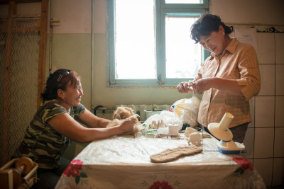 Two women make felt handcrafts at a co-op in Mongolia. Mercy Corps supports families and communities in rural Mongolia with programs focusing on economic opportunity, civil society and natural resource management. Photo by Ben David for Mercy Corps