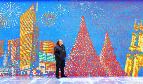 albotas:  It's Real: A Mural of 85,794 Rubik's Cubes In Macau, China, there sits a 13-foot tall, 200-foot long mural made up of 85,794 Rubik's Cubes. Seriously. The project was created by Toronto-based Cube Works Studio, known for contorting Rubik's Cubes into art. The mural hit the 2013 Guiness Book of World Records for the world's largest Rubik's Cube Mosaic. Fucking incredible to say the absolute least about the project.  Follow Albotas on Twitter | Like Albotas on Facebook