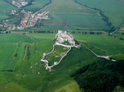 Spišský hrad  | Spiš Castle, Slovakia -  rated one of the 25 most beautiful castles in Europe UNESCO World Heritage  One of the largest Castles of the 13th and 14th century military, political and religious buildings in eastern and central Europe. Location: N48 59 58 E20 46 3 Architecture of Middle Ages and early Renaissance, Romanesque, Gothic  Spišský Hrad (castle) stands on a dramatic site where the earliest occupation dates back to the Neolithic period (5th millennium BC), and subsequently occupied in the Bronze Age and in the 1st century AD. It was also fortified during the Great Moravian Period (9th century AD). Present castle construction started in 12th cent. It was used as a defense against Tatar incursions from the east. The castle is usually compared with contemporary castles in France and the British Isles rather than those of Central and Eastern Europe.