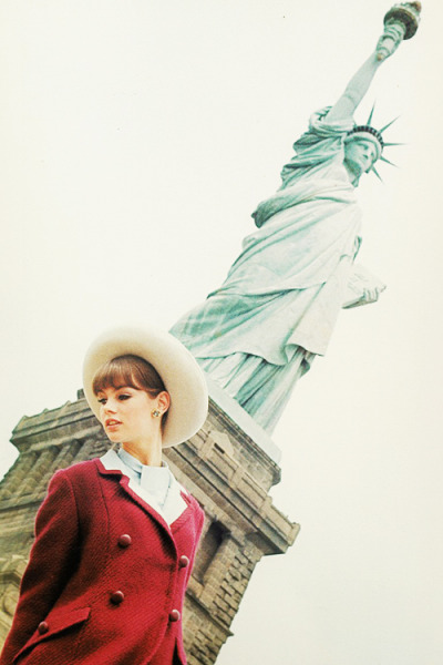 Jean Shrimpton posing in front of the Statue of liberty in New York for Glamour Magazine, 1963