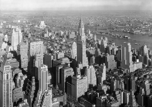"May 1, 1931: President Hoover Dedicates the Empire State Building On this day in 1931, President Hoover dedicated the Empire State Building by ""turning on the lights"" from Washington, D.C. In reality, the action was purely symbolic and someone in New York City actually turned on the lights. Throughout its construction, the Empire State Building was in a constant race with the Chrysler Building to become the tallest building. At completion, the Empire State Building won the title of the tallest skyscraper with 102 floors and a height of 1,250 feet. In 1972, the World Trade Center towers stole the title as the tallest skyscrapers. Today, the Burj Khalifa tower in Dubai holds that title. Check out American Experience's analysis of skyscrapers in Manhattan. Bottom Image: 1932 View from the Empire State Building, New York City (Library of Congress)."