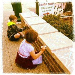 Vandals hard at working tagging the neighborhood.  (at Downtown Rochester)