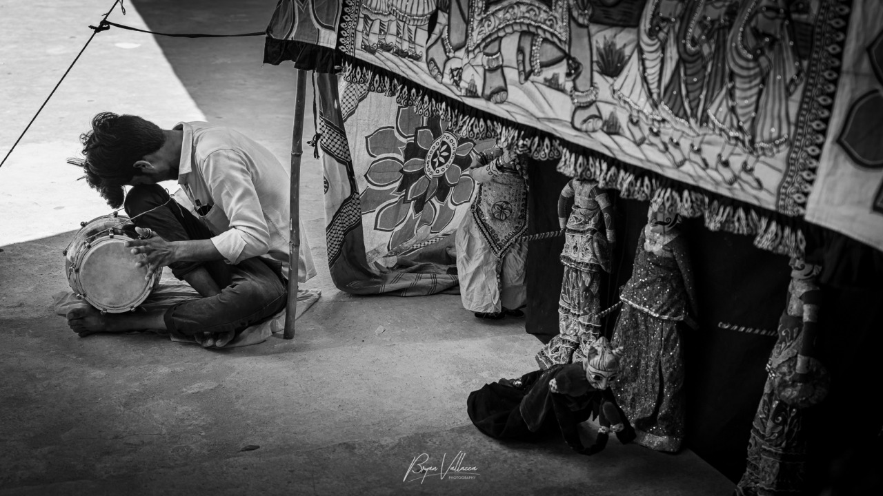 The musician #jaipur#musician#rajasthan#indian#asia#playing#alone#someone#sitting#street#street photography #black and white #monochrome#doll#market#india