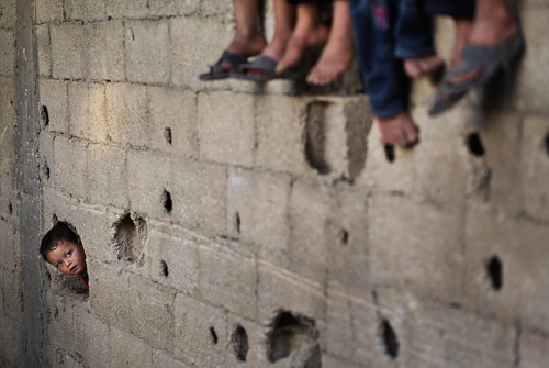 Beit Lahiya, Gaza Strip: Palestinian refugee children play in a poverty-stricken quarter of the town [Photograph: Ali Ali/EPA via the Guardian]