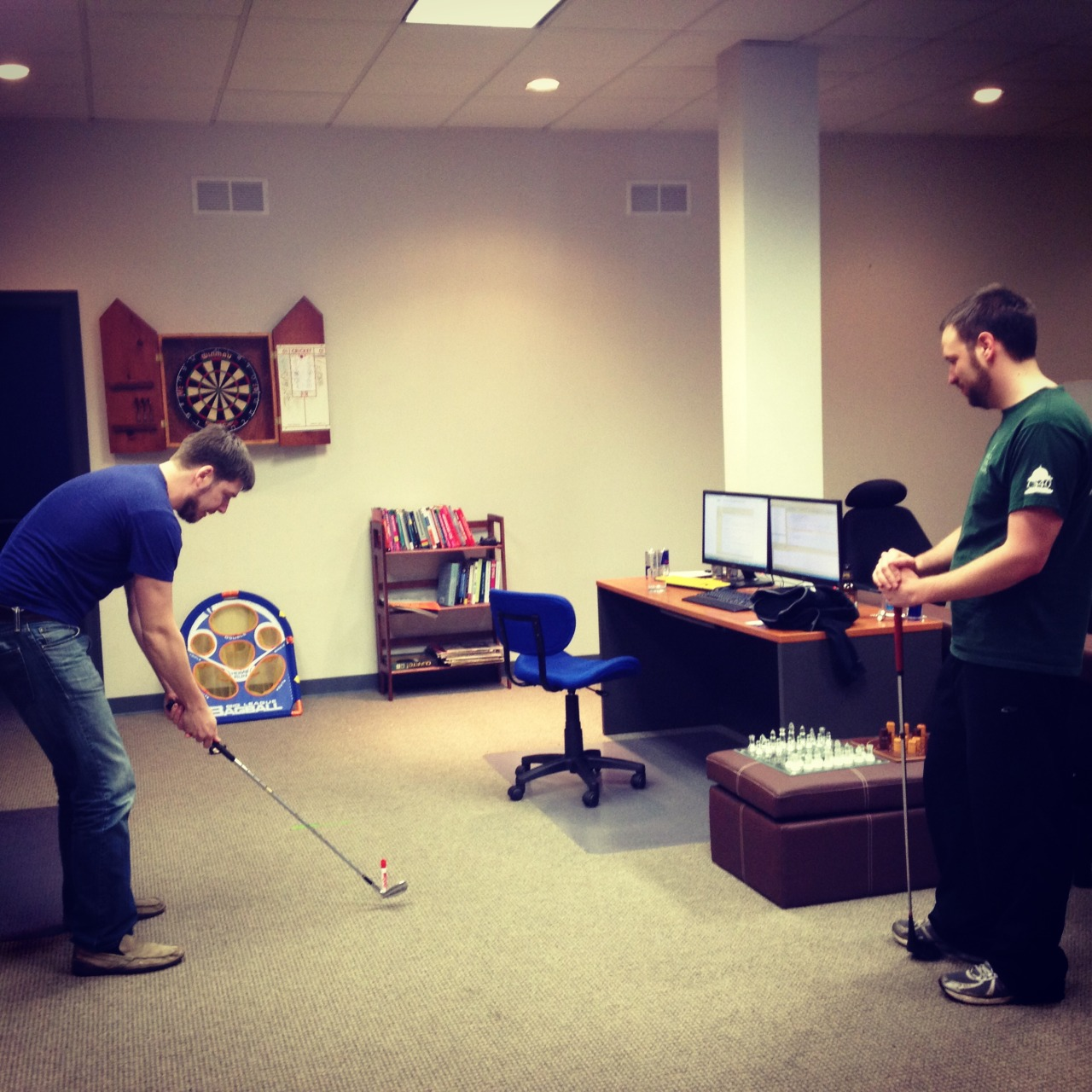 This is what we do at the office on Friday, Ian and Chris were trying to find out what can be substituted for a golf ball and trying to hit around the office. But once I got a hold of a golf club, everybody got really scared.