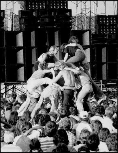 Concertgoers form a human pyramid during intermission at the 1979 Beach Boys concert at Rosenblatt Stadium.
