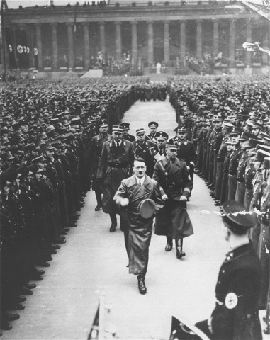 Adolf Hitler walks to his car after addressing an SA rally in the Berlin Lustgarten, convened to celebrate the third anniversary of his chancellorship, 1936.